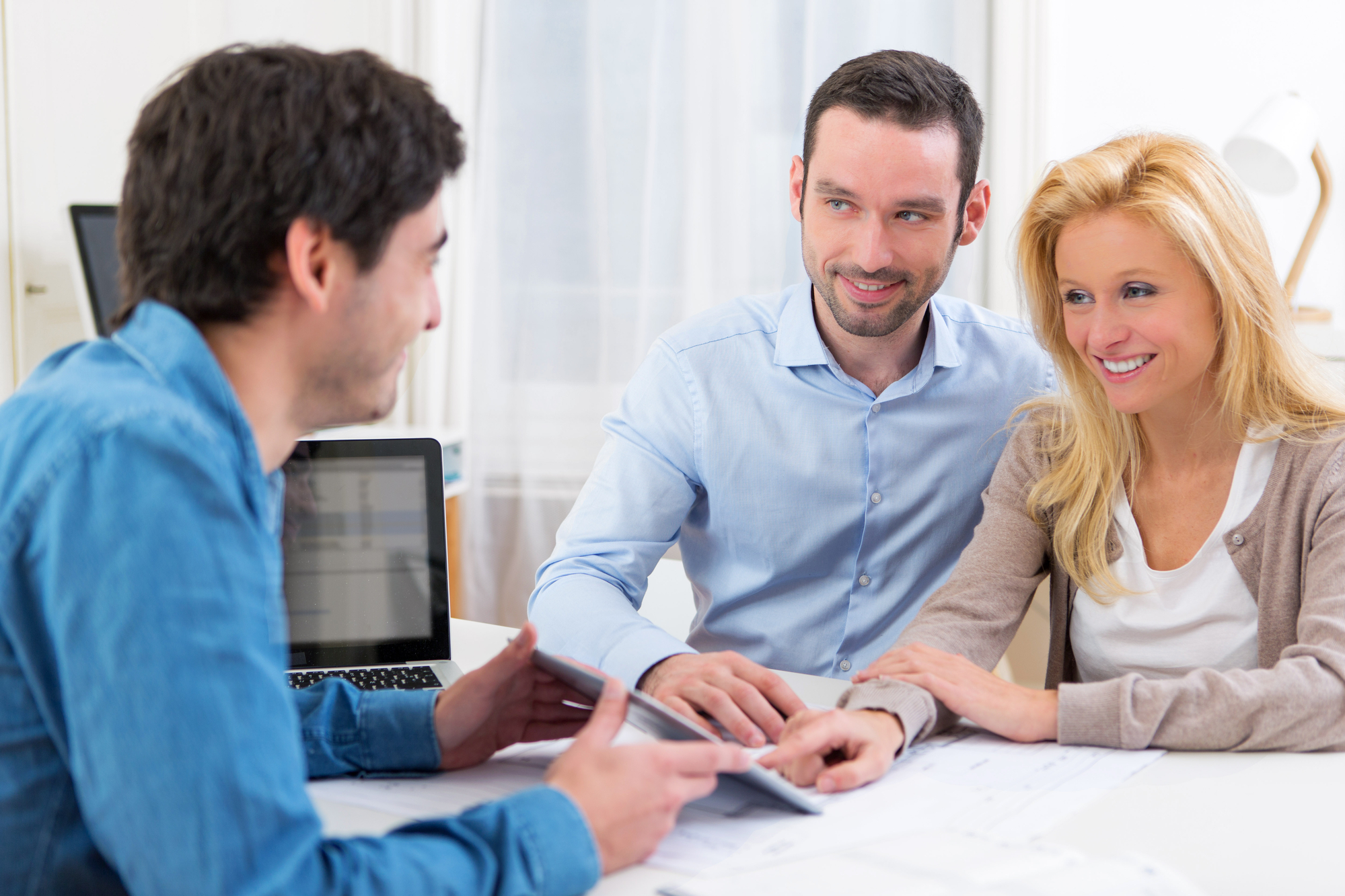 Young attractive couple signing loan offer contract on tablet